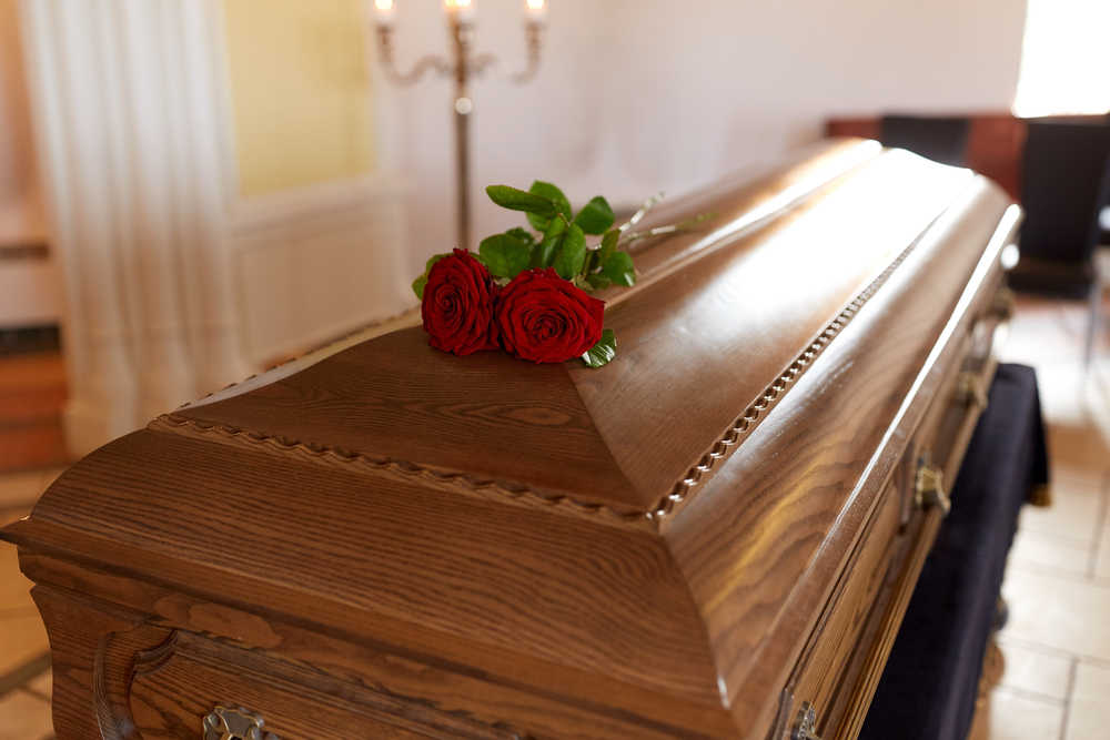 coffin with roses on it wrongful death