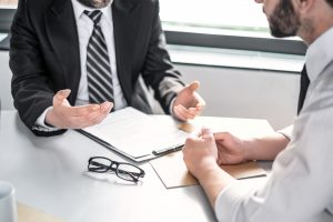 lawyer talking with client